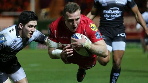 Hadleigh Parkes is airborne as he scores for Scarlets
