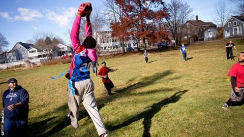 Children playing flag football.