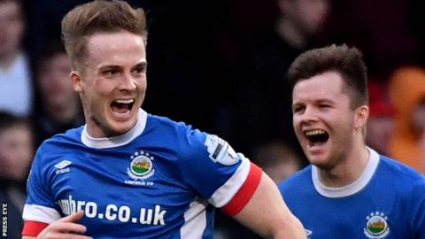 Aaron Burns scored the first goal as Linfield inflicted Crusaders' first home defeat of the Premiership season