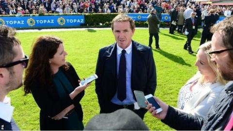 Jockey AP McCoy answering questions from reporters at Galway