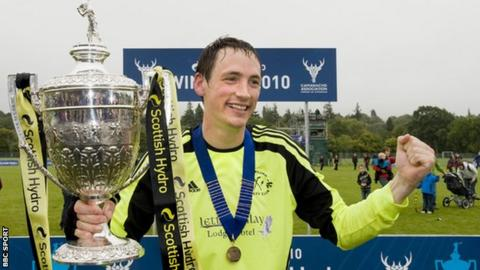 Gary Innes with Camanachd Cup trophy
