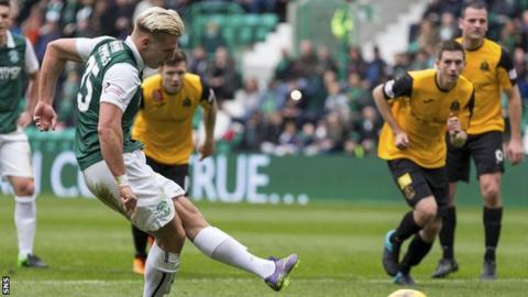 Jason Cummings scores a penalty for Hibernian against Livingston