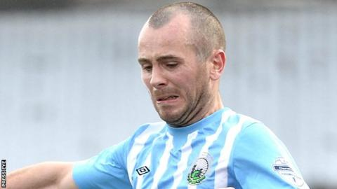 Stephen Hughes will stay in the Premiership after signing for Portadown