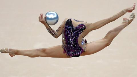 Minsk, Belarus, 23 June: Linoy Ashram of Israel shows her dexterity during the women's ball finals of the rhythmic gymnastics at the European Games, which took place in the Minsk Arena. (Photo by Dean Mouhtaropoulos/Getty Images)