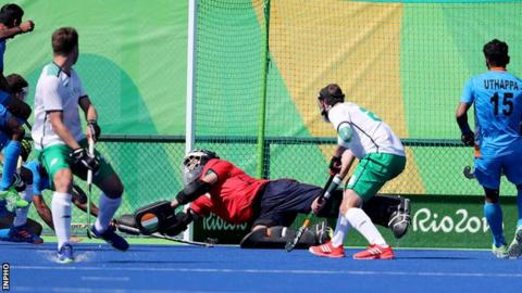 Ireland keeper David Harte fails to keep out this shot as India score in the Pool B game