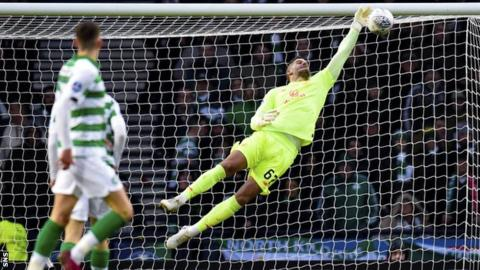 Fraser Forster saves from Ryan Jack in the first half