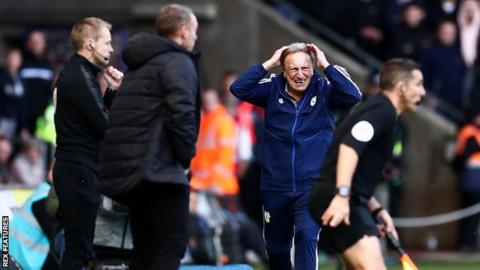 Cardiff boss Neil Warnock shows his frustration during their defeat away to rivals Swansea