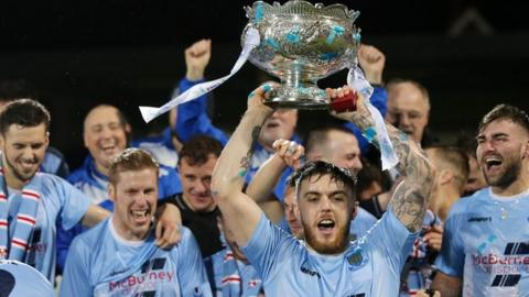 Ballymena United players celebrate after beating Carrick Rangers in the League Cup final in February