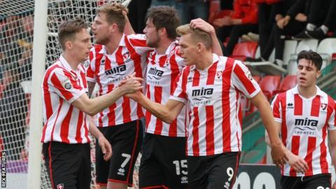Danny Wright (second from right) celebrates his goal against Lincoln