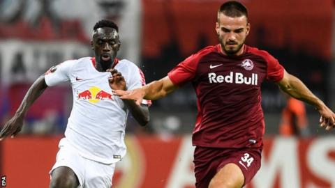 Salzburg's Marin Pongracic and Leipzig's Jean-Kevin Augustin