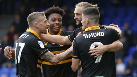 Newport celebrate their opening goal