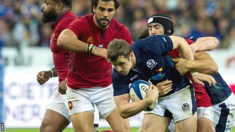 Scotland's Mark Bennett is tackled by Alexandre Dumoulin