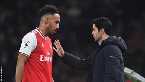 Arsenal captain Pierre-Emerick Aubameyang (left) speaks to manager Mikel Arteta (right) during a match