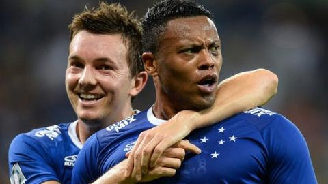 Julio Baptista is congratulated by a team-mate after scoring for Cruzeiro