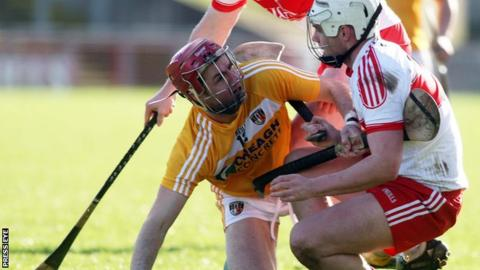 Antrim's Liam Watson has words with Derry player Conor McSorley