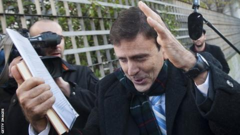 Spanish doctor Eufemiano Fuentes tries to avoid the media at his trial in Madrid in January 2013