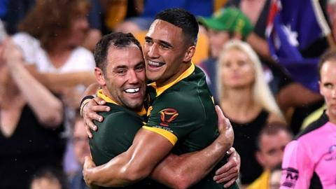 Valentine Holmes (right) celebrates scoring with skipper Cameron Smith