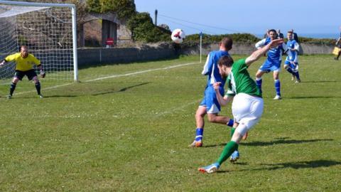 Ross Allen crosses for Guernsey
