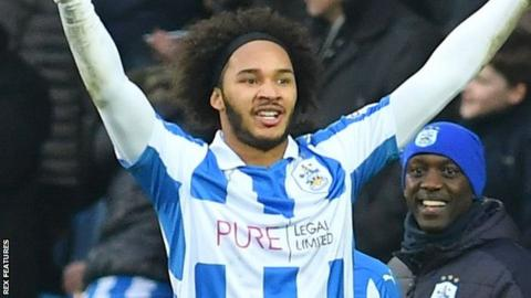 Isaiah Brown celebrates his first Huddersfield goal