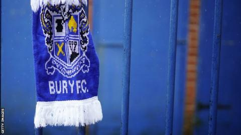 Bury scarf tied to the fence