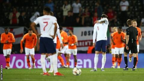 England players (including John Stones - number five) look distraught