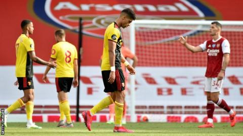 Watford players look dejected after defeat by Arsenal on Sunday