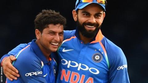 Kuldeep Yadav (left) with India captain Virat Kohli