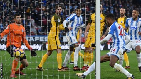 Steve Mounie bundles in for Huddersfield