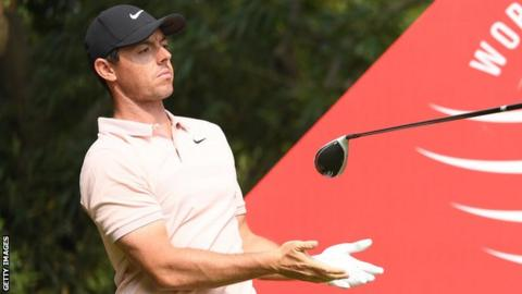 Rory McIlroy lets go of his club after his drive at the ninth tee