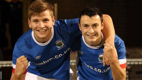 Man of the match Cameron Stewart celebrates with Jonny Frazer who scored all three goals for Linfield Swifts in the 3-2 win over Crumlin Star