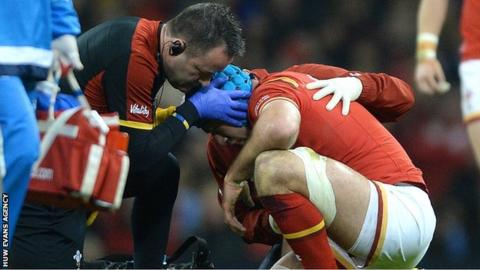 Justin Tipuric is treated before departing against Italy