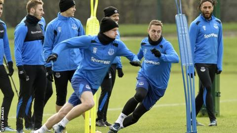 Phil Jagielka and Wayne Rooney start a sprinting drill at Everton's Finch Farm training ground