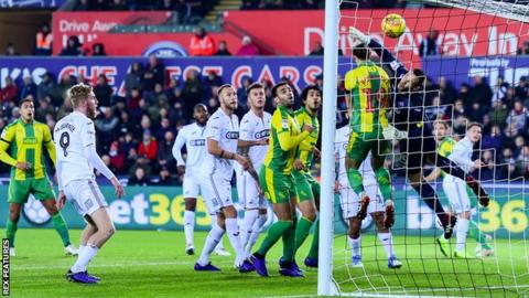 Craig Dawson beats a full-stretch Erwin Mulder to level for West Brom at Swansea