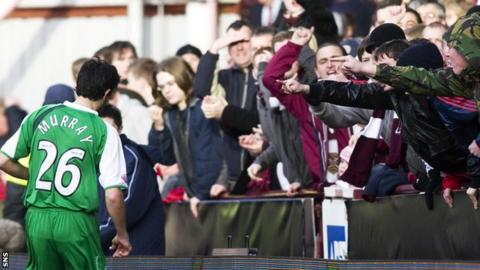 Ian Murray retrieves a ball from in front of Hearts supporters at Tynecastle