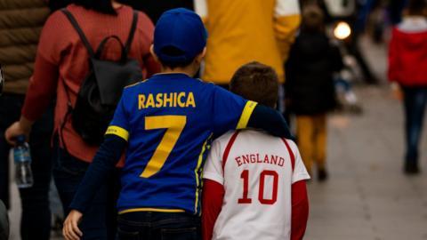 Children wearing Kosovo and England shirts