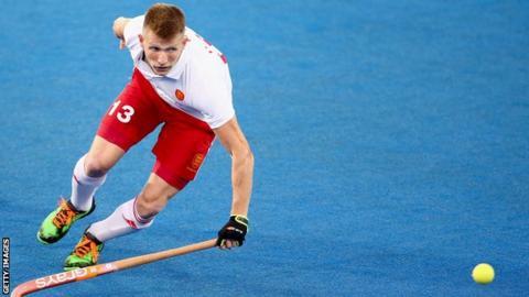 Sam Ward playing hockey