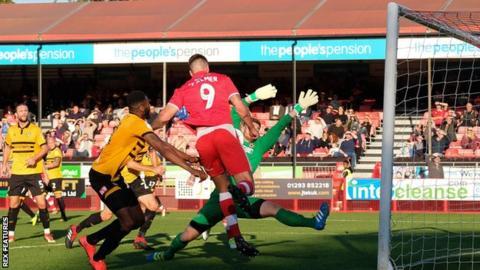 Ollie Palmer bundles home Crawley Town's third goal