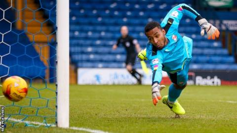 Swindon's Lawrence Vigouroux is one of three goalkeepers in Chile's 24-man squad