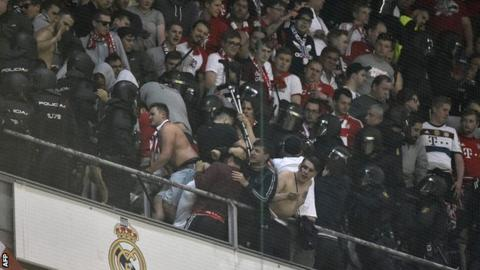 Spanish riot police clashed with Bayern Munich fans during the Champions League quarter-final at Real Madrid on 18 April