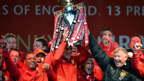 Manchester United manager Alex Ferguson and his players celebrate winning the Premier League for the 13th time.