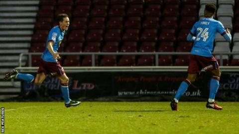 League One joint top scorer Josh Morris struck his 18th goal of the season to earn victory for the Iron at Sixfields