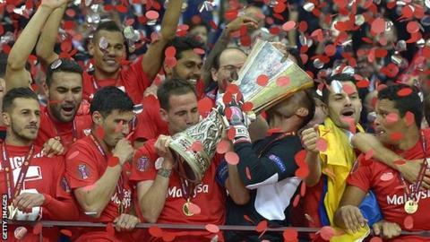 Sevilla players celebrate winning the 2015 Europa League