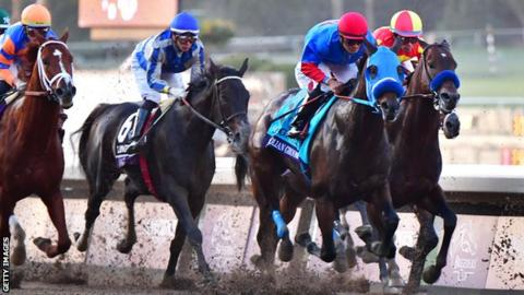 Jockey Abel Cedillo rides Mongolian Groom (second from right) at the Breeders' Cup