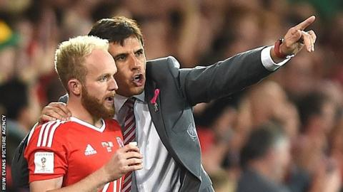 Jonny Williams receives instructions from Wales manager Chris Coleman
