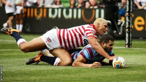 Ryan Hall and Greg Inglis compete for the ball during their match in 2014