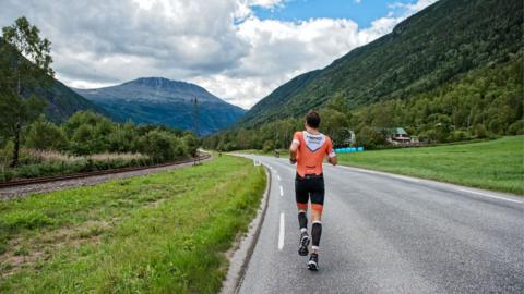 EIDFJORD, NORWAY - AUGUST 04: In this handout image provided by Isklar Norseman Extreme Triathlon, the run leg at the foot of mount Gaustatoppen during the Isklar Norseman Extreme Triathlon on August 4, 2018 in Eidfjord, Norway. 250 athletes participate in the 3.8 kilometers swim leg, 180 kilometers bike leg and the 42.2 kilometers run leg up to Mount Gausta, with the fastest athlete expected to finish the extreme triathlon in almost 11 hours. (Photo by Agurtxane Concellon/Iskar Norseman Xtreme Triathlon via Getty Images)
