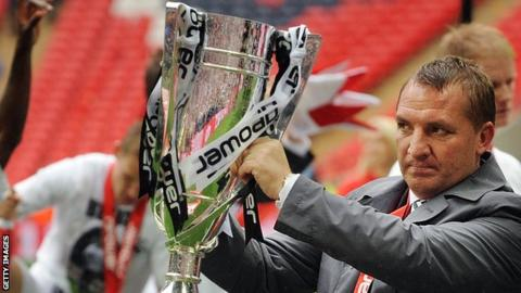 Brendan Rodgers celebrates guiding Swansea to the Premier League in the play-off final against former club Reading