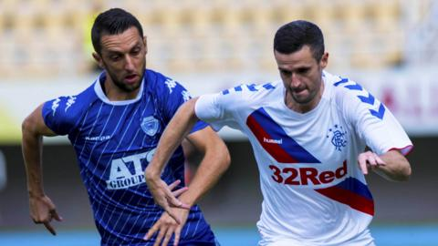 Rangers Jamie Murphy and S. Vujcic in action.