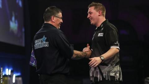 Gary Anderson shakes hands with Chris Dobey after winning their last 16 tie of the PDC World Championship at Alexandra Palace