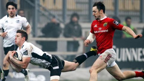 Zebre's Kayle Van Zyl is chased by Munster's Darren Sweetnam